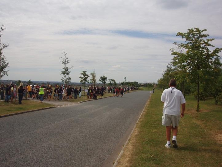 The site access road, which was the only safe place to load coaches – here are passengers waiting
